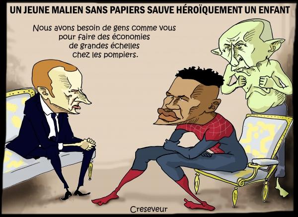 Macron reçoit un héros sans papiers.jpg